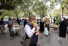 A blind man plays harmonica at the grand Bazar in central Tehran REUTERS/Raheb Homavandi