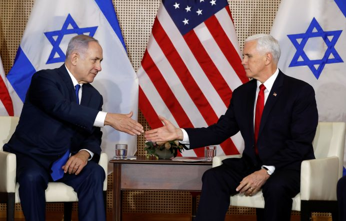 U.S. Vice President Mike Pence and Israeli Prime Minister Benjamin Netanyahu shake hands as they meet in Warsaw, Poland, February 14, 2019. REUTERS/Kacper Pempel