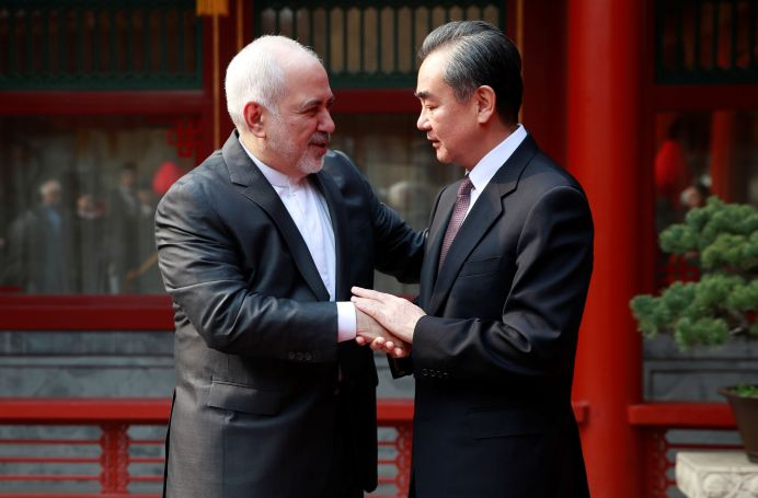Iranian Foreign Minister Mohammad Javad Zarif (L) and his Chinese counterpart Wang Yi shake hands during their meeting at the Diaoyutai State Guesthouse in Beijing, China February 19, 2019. How Hwee Young/Pool via REUTERS