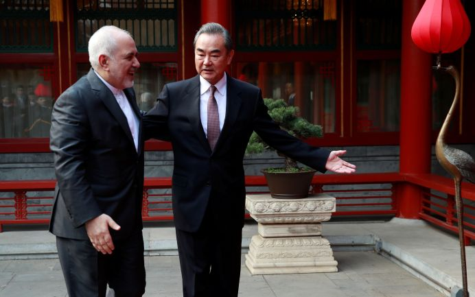 FILE PHOTO: Chinese Foreign Minister Wang Yi (R) gestures to his Iranian counterpart Mohammad Javad Zarif during their meeting at the Diaoyutai State Guesthouse in Beijing, China February 19, 2019. REUTERS./