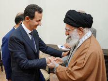 FILE PHOTO: Syria's President Bashar al-Assad shakes hands with Iranian Supreme Leader Ayatollah Ali Khamenei in Tehran, Iran. REUTERS./