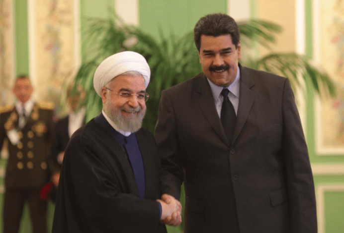 Nicolas Maduro (R) is welcomed by Hassan Rouhani in Tehran January 10, 2015. REUTERS