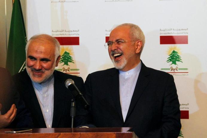 Mohammad Javad Zarif (R). REUTERS/Aziz Taher