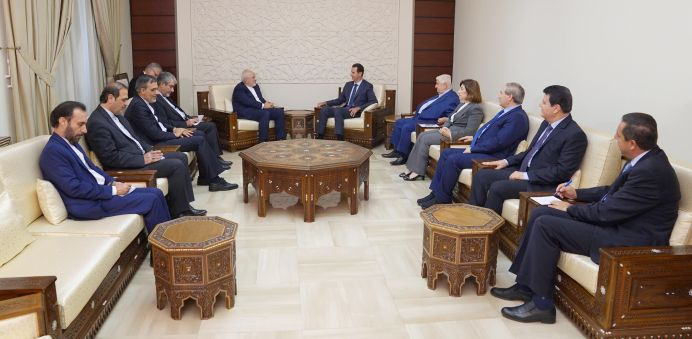 Syrian President Bashar al-Assad meets with Iran's Foreign Minister Mohammad Javad Zarif in Damascus, Syria September 3, 2018. REUTERS