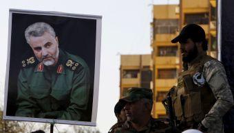 FILE PHOTO: A portrait of Quds Force Commander Major General Qassem Soleimani is held up in Baghdad, Reuters.