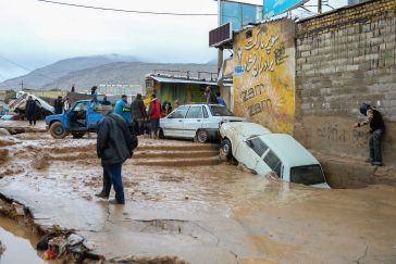 Damaged vehicles are seen after a flash flooding in Shiraz, Iran, March 26, 2019. Reuters