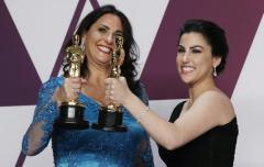 "91st Academy Awards - Oscars Photo Room - Hollywood, Los Angeles, California, U.S., February 24, 2019. Rayka Zehtabchi and Melissa Berton pose backstage with their award for Best Documentary Short Subject award for the film ""Period. End Of Sentence."" REUTERS/Mike Segar"