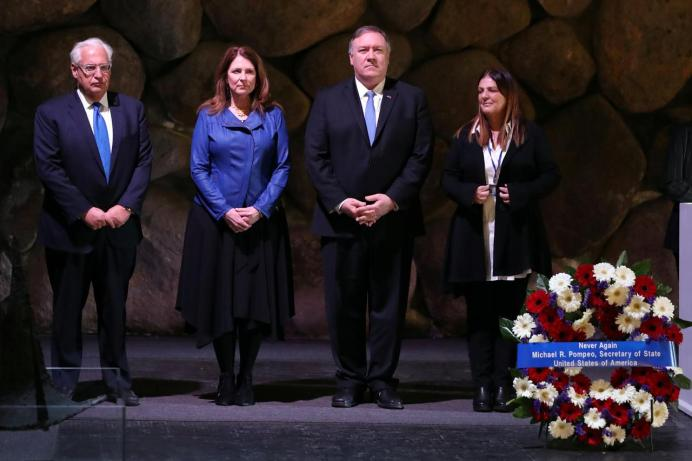 U.S. Secretary of State Mike Pompeo and his wife Susan stand next to U.S. Ambassador to Israel David Friedman at a ceremony commemorating the six million Jews killed by the Nazis during the Holocaust, in the Hall of Remembrance at Yad Vashem World Holocaust Remembrance Center in Jerusalem March 21, 2019. REUTERS/Ammar Awad
