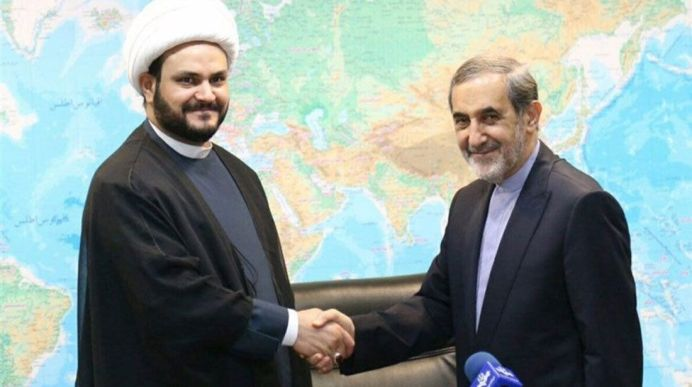 HANDSHAKE: Cleric Akram Kaabi, the leader of Nujaba, meets Ali Akbar Velayati, senior adviser to Supreme Leader Ayatollah Ali Khamenei. Reuters