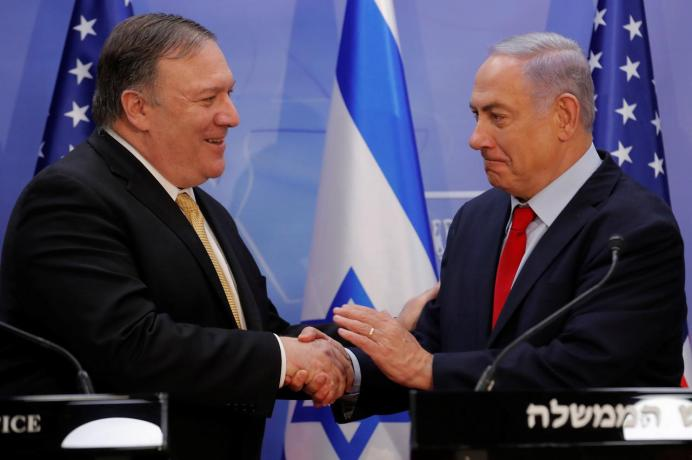 U.S. Secretary of State Mike Pompeo and Israeli Prime Minister Benjamin Netanyahu shake hands as they deliver joint statements during their meeting in Jerusalem March 20, 2019. REUTERS/Jim Young/Pool