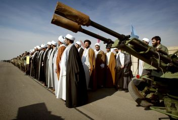 FILE PHOTO: Iranian clerics stand at a military base during a rally to commemorate Basij week after creating a human chain in support of Iran's nuclear programme in Tehran.Reuters