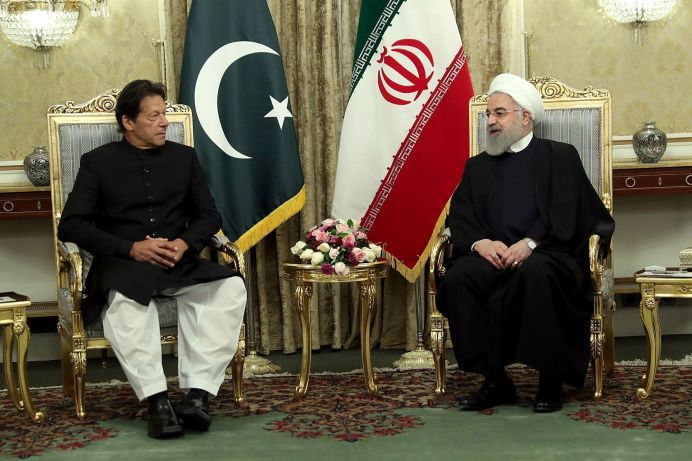 FILE PHOTO: Iranian President Hassan Rouhani meets with Pakistani Prime Minister Imran Khan in Tehran, Iran, April 22, 2019. REUTERS./