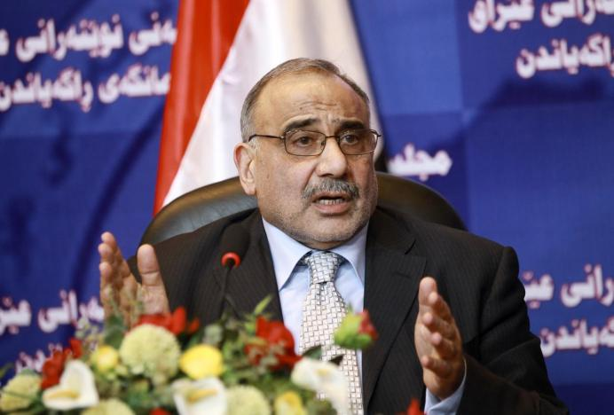 FILE PHOTO: Adel Abdul-Mahdi speaks during a news conference. Reuters