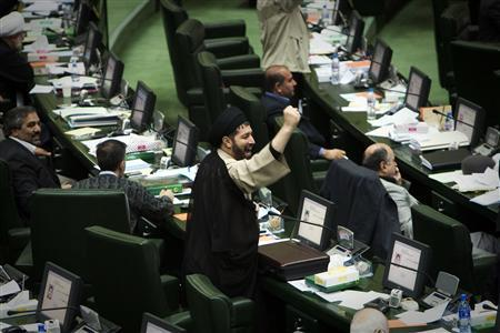 FILE PHOTO: An Iranian Member of Parliament (MP) shakes his fist as he chants anti-Britain slogans during a debate in parliament. REUTERS