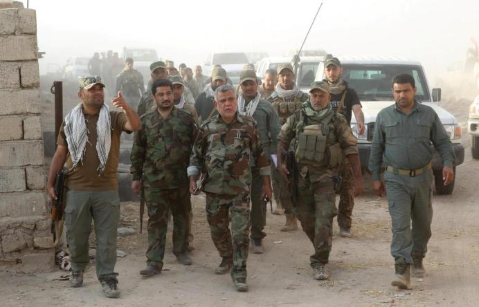 FILE PHOTO: Head of the Badr Organisation Hadi al-Amiri (C) walks with Shi'ite fighters south of Mosul, Iraq October 30, 2016. REUTERS/Stringer