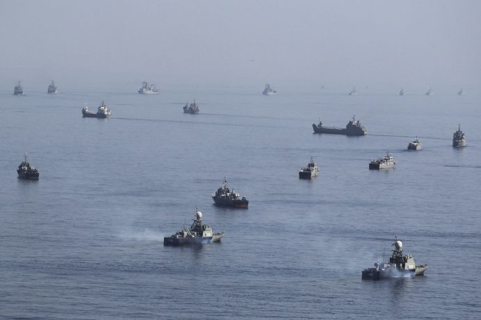 FILE PHOTO: Iranian ships participate in a naval parade on the last day of the Velayat-90 war game on the Sea of Oman near the Strait of Hormuz in southern Iran.
