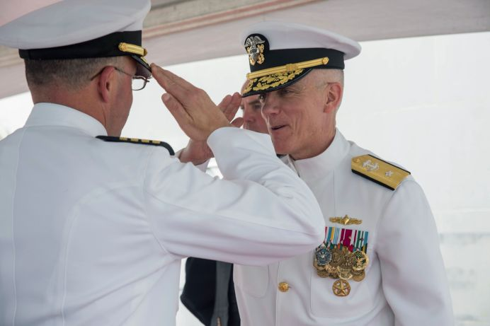 FILE PHOTO: U.S. Navy Rear Admiral Jim Malloy (R), commander of Carrier Strike Group 10, is saluted during a change of command ceremony onboard the USS Dwight D. Eisenhower during deployment in Norfolk, Viginia, U.S., in this undated photo. U.S. Navy/Handout via REUTERS