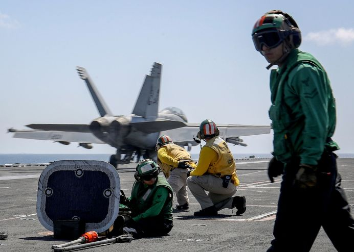 """FILE PHOTO: An F/A-18E Super Hornet from the """"Jolly Rogers"""" of Strike Fighter Squadron (VFA) 103 launches from the flight deck of the Nimitz-class aircraft carrier USS Abraham Lincoln (CVN 72), in Arabian Sea, May 20, 2019. Picture taken May 20, 2019. Jeff Sherman/U.S. Navy/Handout via"""