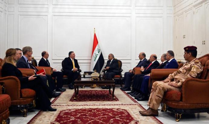 FILE PHOTO: U.S. Secretary of State Mike Pompeo (L) talks with Iraqi Prime Minister Adel Abdul-Mahdi (R) in Baghdad, Iraq, during a Middle East tour, January 9, 2019.