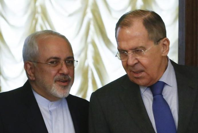 FILE PHOTO: Russia's Foreign Minister Sergei Lavrov (R) and his Iranian counterpart Mohammad Javad Zarif enter a hall during a meeting in Moscow, Russia. REUTERS/Sergei Karpukhin