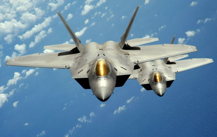 FILE PHOTO: Two U.S. Air Force F-22 Raptor stealth jet fighters fly near Andersen Air Force Base. REUTERS