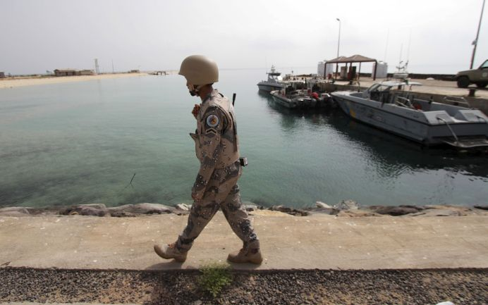 FILE PHOTO: A Saudi border guard patrols Saudi Arabia's maritime border with Yemen along a beach on the Red Sea, near Jizan. REUTERS/Faisal Al Nasser