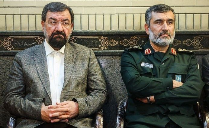 FILE PHOTO: Mohsen Rezaee, previous commander of the Army of the Guardians of the Islamic Revolution (left) and Hajizaded, commander of Aerospace Force of the Army of the Guardians of the Islamic Revolution (right) Source:https://newsmedia.tasnimnews.com/Tasnim/Uploaded/Image/1395/01/15/139501151931289917448374.jpg Author:Mohammad Ali Marizad. [This file is licensed under the Creative Commons Attribution 4.0 International license.]
