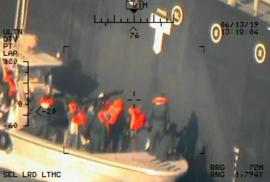 A U.S. military image released by the Pentagon in Washington on June 17, shows what the Pentagon says are members of the Islamic Revolutionary Guard Corps Navy photographed from a U.S. Navy MH-60R helicopter after removing an unexploded limpet mine from the M/T Kokuka Courageous, a Japanese owned commercial motor tanker, after it was attacked with another mine which did explode on June 13, 2019. U.S. Navy/Handout via REUTERS