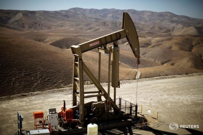 FILE PHOTO: A pumpjack brings oil to the surface in the Monterey Shale, California, U.S. REUTERS/Lucy Nicholson
