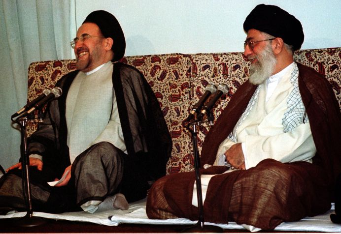 FILE PHOTO: Iranian President Mohammad Khatami (L) enjoys a laugh while introducing his new cabinet to Iranian Supreme Leader Ayatollah Ali Khamenei (R) in Tehran August 27, 2001. REUTERS