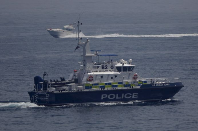 FILE PHOTO: A Gibraltarian Royal Police boat patrols waters next to a boat near the Sandy Bay, at the Mediterranean Sea, in Gibraltar. REUTERS/Jon Nazca