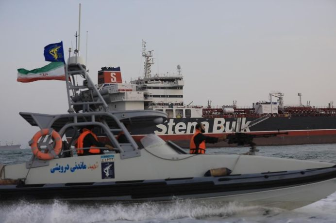 FILE PHOTO: A boat of Iranian Revolutionary Guard sails next to Stena Impero, a British-flagged vessel owned by Stena Bulk, at Bandar Abbas port. REUTERS./