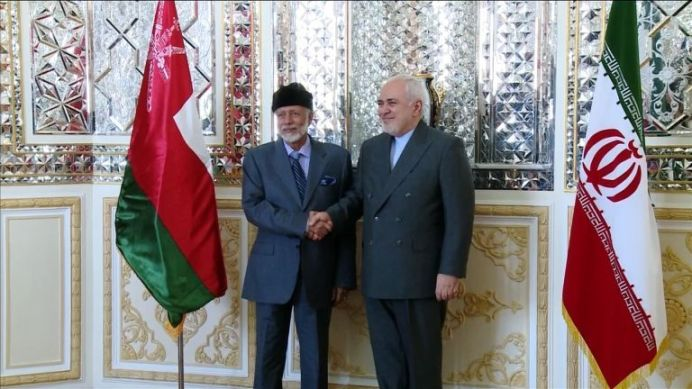 Mohammad Javad Zarif Greeting Oman Foreign Minister Yousuf Bin Alawi Bin Abdullah. REUTERS./