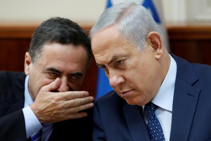 FILE PHOTO: Israeli Prime Minister Benjamin Netanyahu (R) listens to Yisrael Katz. REUTERS/Gali Tibbon/Pool