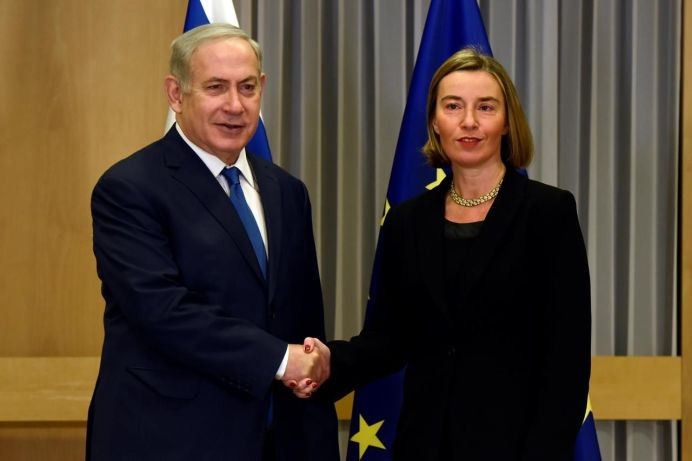 FILE PHOTO: EU foreign policy chief Federica Mogherini shakes hands with Israeli Prime Minister Benjamin Netanyahu at the European Council headquarters in Brussels, Belgium December 11, 2017. REUTERS/Eric Vidal