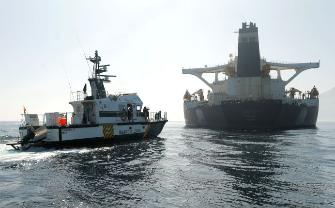FILE PHOTO: A Spanish Civil Guard ship sails next to Iranian oil tanker, in the Strait of Gibraltar, southern Spain, August 16, 2019. REUTERS/Jon Nazca