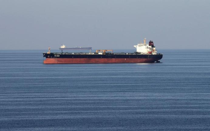 FILE PHOTO: Oil tankers pass through the Strait of Hormuz. REUTERS/Hamad I Mohammed