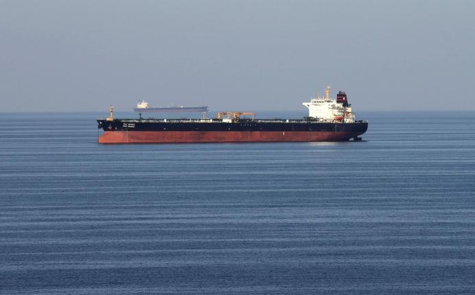 FILE PHOTO: Oil tankers pass through the Strait of Hormuz, December 21, 2018. REUTERS/Hamad I Mohammed - RC1F33C0B450/File Photo