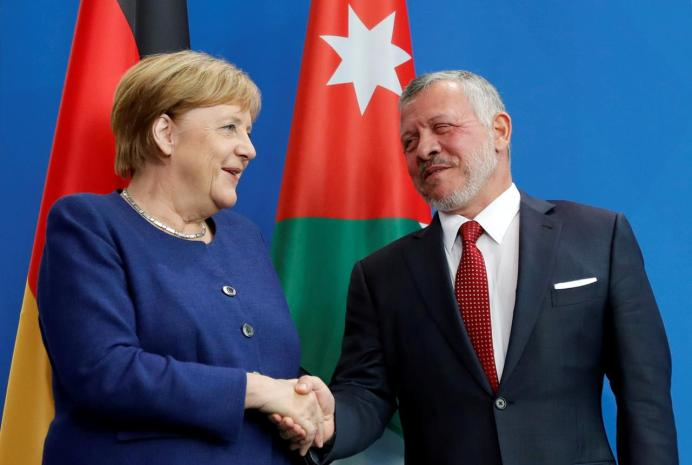 German Chancellor Angela Merkel and Jordan's King Abdullah react at a joint news conference in Berlin, Germany September 17, 2019. REUTERS/Fabrizio Bensch