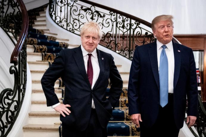 FILE PHOTO: U.S. President Donald Trump and Britain's Prime Minister Boris Johnson arrive for a bilateral meeting during the G7 summit in Biarritz, France, August 25, 2019. Erin Schaff/Pool via REUTERS