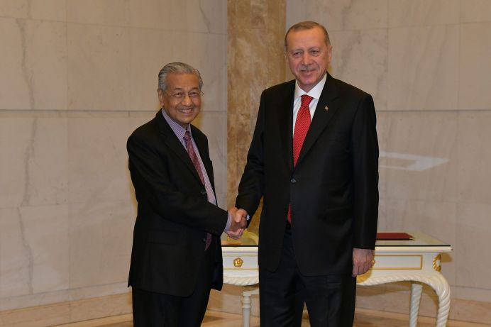 Malaysia's Prime Minister Mahathir Mohamad shakes hands with Turkey's President Recep Tayyip Erdogan at Prime Minister Office in Putrajaya, Malaysia, December 18, 2019.