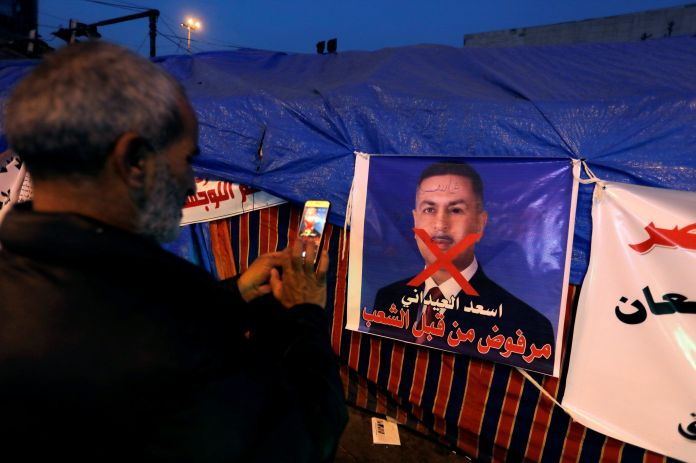 2019-12-26T152701Z_884840773_RC233E97UJS4_RTRMADP_3_IRAQ-PROTESTS-scaled