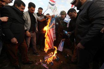 Burning of an Israeli and a U.S. flag at the headquarters of Kataib Hezbollah militia group in Qaim, in Kirkuk, Iraq, December 30, 2019. REUTERS/Ako Rasheed