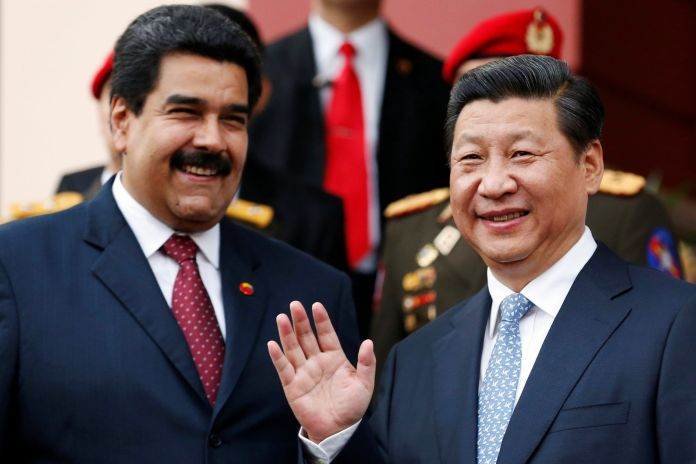 FILE PHOTO: China's President Xi Jinping (R) attends a meeting with Venezuela's President Nicolas Maduro at Miraflores Palace in Caracas.