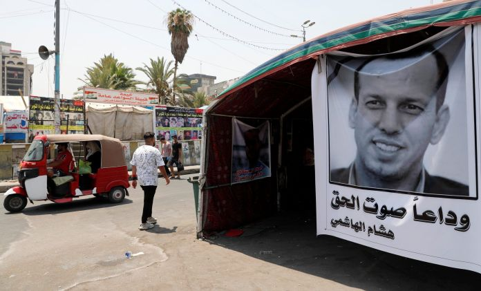 A poster depicting the former government advisor and political analyst Hisham al-Hashemi, who was killed by gunmen is seen at the Tahrir Square in Baghdad, Iraq July 8, 2020. REUTERS/Thaier al-Sudani