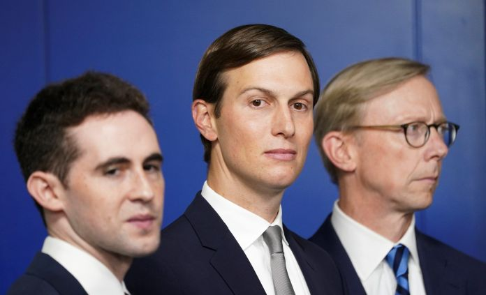 White House adviser Jared Kushner, flanked by aide Avi Berkowitz (L) and Brian Hook, former U.S. envoy to Iran, during a press briefing on the agreement between Israel and the United Arab Emirates at White House in Washington, U.S., August 13, 2020.  REUTERS/Kevin Lamarque