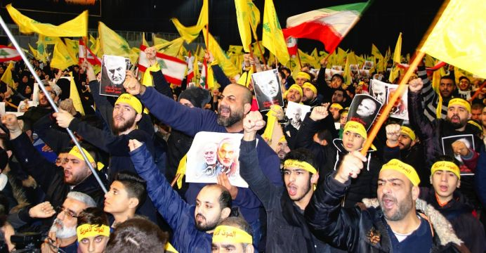 """FILE PHOTO: People shout """"Death for US Army"""" responding to Hezbollah leader Sayyed Hassan Nasrallah to revenge for the assassination of the Commander of Iran's Islamic Revolution Guards Corps (IRGC) Quds Force Major General Qasem Soleimani in Beruit, Lebanon on Jan. 5, 2019. REUTERS./"""