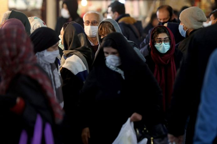 FILE PHOTO: People walk in Tajrish bazaar that reopened after a two-week shutdown, amid the coronavirus disease (COVID-19) outbreak, in Tehran, Iran December 5, 2020. REUTERS./