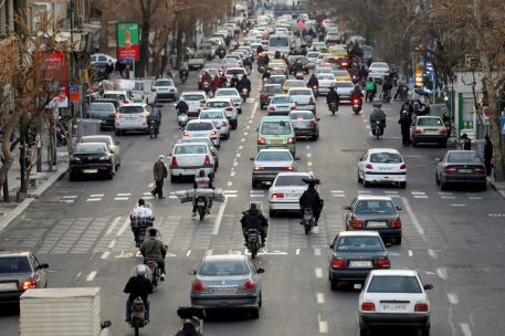 People ride their motorbikes as vehicles drive along a street in center of Tehran, Iran. REUTERS./FILE PHOTO.