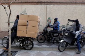 A man rides a motorbike as he carries a load, in Tehran, Iran January 21, 2021. Picture taken January 21, 2021. Majid Asgaripour/WANA (West Asia News Agency) via REUTERS ATTENTION EDITORS - THIS IMAGE HAS BEEN SUPPLIED BY A THIRD PARTY.
